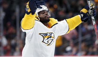 Nashville Predators defenseman P.K. Subban celebrates at the end of the team's NHL hockey game against the Colorado Avalanche on Friday, March 16, 2018, in Denver. The Predators won 4-2. (AP Photo/David Zalubowski)