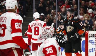 Anaheim Ducks' Corey Perry, right, celebrates his goal against the Detroit Red Wings during the second period of an NHL hockey game Friday, March 16, 2018, in Anaheim, Calif. (AP Photo/Jae C. Hong)