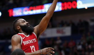 Houston Rockets guard James Harden (13) goes to the basket in front of New Orleans Pelicans forward E'Twaun Moore (55) in the first half of an NBA basketball game in New Orleans, Saturday, March 17, 2018. (AP Photo/Gerald Herbert)