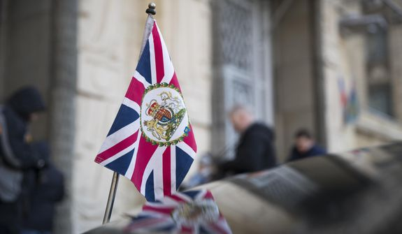 The British Union flag flies from the front of a car as British ambassador to Russia, Laurie Bristow attends a meeting at the Russian foreign ministry building in Moscow, Russia, Saturday, March 17, 2018. Russia's Foreign Ministry has summoned Bristow for talks in a heightening dispute over a nerve agent attack on a former spy in Britain. Russia is expected to announce the expulsion of some British diplomats in a retaliatory measure. (AP Photo/Pavel Golovkin)