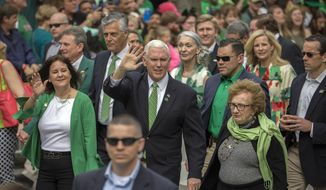 Vice President Mike Pence, center, his wife Karen Pence, left, and his mother Nancy Pence Fritch, right, march in the St. Patrick's Day parade Saturday, March 17, 2018, in Savannah, Ga.  Irish immigrants to Savannah and their descendants have been celebrating St. Patrick's Day with a parade since 1824. (AP Photo/Stephen B. Morton)