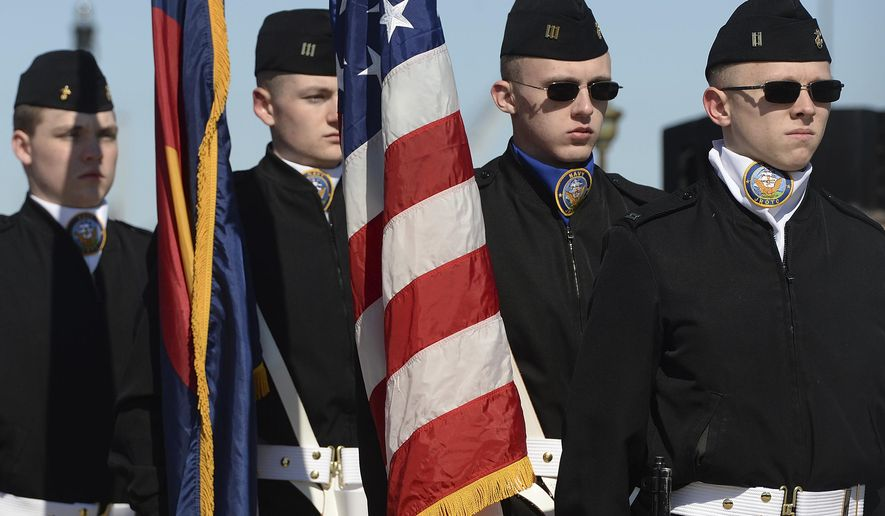 The Navy JROTC color guard from Widefield High School in Colorado Springs, Colo., parade the colors at the start of the commissioning ceremony for the Virginia-class fast attack submarine USS Colorado (SSN 788) at Naval Submarine Base New London in Groton, Conn., Saturday, March 17, 2018. (Dana Jensen/The Day via AP) ** FILE **