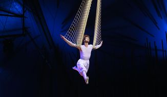 "A Cirque Du Soleil artist performs a rehearsal of ""Varekai"" in Rio de Janeiro, Brazil, Wednesday, Dec. 7, 2011. (AP Photo/Victor R. Caivano)"