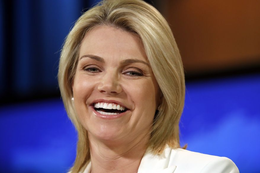 """State Department spokeswoman Heather Nauert speaks during a briefing at the State Department in Washington, Wednesday, Aug. 9, 2017. The State Department says President Donald Trump is """"on the same page"""" with the rest of U.S. government with his fiery threat to North Korea. Nauert said the White House, State Department and Pentagon are all in agreement. She says the world, too, is speaking with one voice. (AP Photo/Alex Brandon)"""