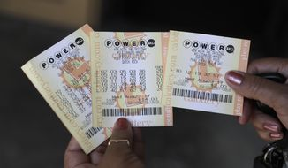 Powerball tickets are shown outside of a a liquor store Wednesday, Aug. 23, 2017, in Fremont, Calif. Officials estimated jackpot for Wednesday night's Powerball lottery game has climbed to $700 million, making it the second largest in U.S. history. (AP Photo/Marcio Jose Sanchez)