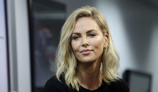 Actress Charlize Theron listens to a question during a news conference before the NASCAR Daytona 500 Cup series auto race at Daytona International Speedway in Daytona Beach, Fla., Sunday, Feb. 18, 2018. (AP Photo/Terry Renna) ** FILE **
