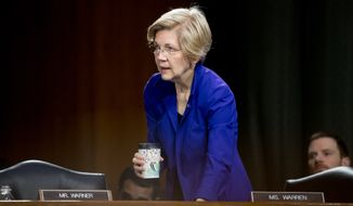 Sen. Elizabeth Warren, D-Mass., arrives as  Federal Reserve Chair Janet Yellen testifies in front of the Senate Banking Committee in Washington, Tuesday, Feb. 14, 2017. (AP Photo/Andrew Harnik)