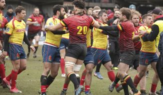 Spain players, in yellow, clash with Romania referee Vlad Iordachescu, after the Rugby Europe Championship match between Belgium and Spain at the Little Heysel Stadium in Brussels, Sunday, March 18, 2018. (AP Photo/Olivier Matthys) ** FILE **