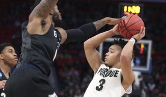 Purdue guard Carsen Edwards (3) looks to pass as Butler forward Tyler Wideman defends during the first half of a second round game against Butler in the NCAA college basketball tournament, Sunday, March 18, 2018, in Detroit. (AP Photo/Carlos Osorio)