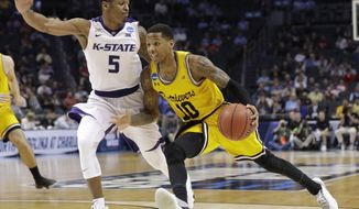 UMBC's Jairus Lyles (10) drives against Kansas State's Barry Brown (5) during the second half of a second-round game in the NCAA men's college basketball tournament in Charlotte, N.C., Sunday, March 18, 2018. (AP Photo/Gerry Broome) ** FILE **