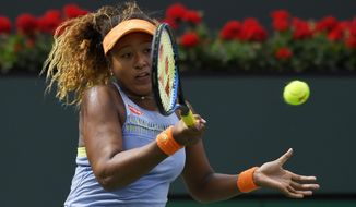 Naomi Osaka, of Japan, returns a shot to Daria Kasatkina, of Russia, in the women's final at the BNP Paribas Open tennis tournament, Sunday, March 18, 2018, in Indian Wells, Calif. Osaka won 6-3, 6-2. (AP Photo/Mark J. Terrill)