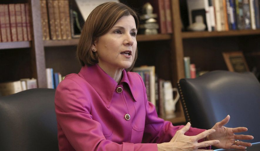 In this March 12, 2018 photo, Minnesota Attorney General Lori Swanson speaks during an interview at the State Capitol in St. Paul, Minn. Swanson said she's particularly proud of the $850 million settlement she reached with 3M last month in a lawsuit alleging the manufacturer's chemicals contaminated groundwater in the eastern Twin Cities metro area. It's the largest environmental settlement in Minnesota history, and the third-largest natural resource damage settlement in U.S. history.  (AP Photo/Jim Mone)
