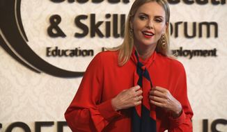 "Actress Charlize Theron speaks at an event at the Global Education and Skills Forum in Dubai, United Arab Emirates, Saturday, March 17, 2018. Theron said Saturday that the idea of arming teachers after recent U.S. school shootings or otherwise ""adding more guns"" to the situation is ""so outrageous."" (AP Photo/Jon Gambrell)"