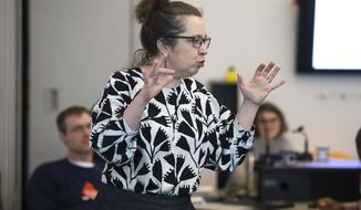 In this Feb. 26, 2018 photo, lecturer Marta Shore addresses false negatives in her graduate level biostatistics course in Bruininks Hall in Minneapolis. Shore joined the union effort around 2015, when teaching four classes, advising more than 200 statistics undergraduates and working between 60 and 70 hours most weeks made her exhausted and stressed. (Ellen Schmidt/Star Tribune via AP)
