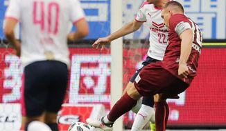 Vissel Kobe's Lukas Podolski, right, scores a goal against Cerezo Osaka in the second half of their J-League season soccer match in Kobe, western Japan, Sunday, March 18, 2018. Kobe won 2-0. (Kyodo News via AP)