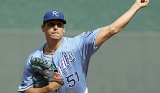 FILE- In this Oct. 1, 2017, file photo, Kansas City Royals starting pitcher Jason Vargas throws during the first inning of a baseball game against the Arizona Diamondbacks in Kansas City, Mo. Vargas is expected to miss four to six weeks after fracturing a bone in his right hand. The 35-year-old Vargas was hit on the hand by a line drive during a minor league game Friday, March 16, 2018. (AP Photo/Charlie Riedel, File)