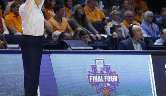Tennessee head coach Holly Warlick watches the second half of a second-round game against Oregon State in the NCAA college basketball tournament Sunday, March 18, 2018, in Knoxville, Tenn. (AP Photo/Wade Payne)