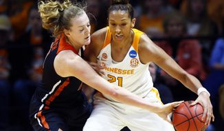 Oregon State center Marie Gulich, left, knocks the ball away Tennessee center Mercedes Russell, right,  in the first half of a second-round game in the NCAA college basketball tournament Sunday, March 18, 2018, in Knoxville, Tenn. (AP Photo/Wade Payne)