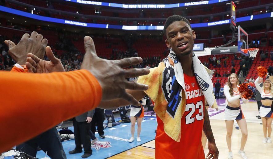 Syracuse guard Frank Howard celebrates after defeating Michigan State in an NCAA men's college basketball tournament second-round game in Detroit, Sunday, March 18, 2018. (AP Photo/Paul Sancya)