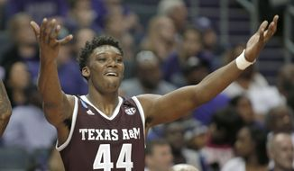 Texas A&M's Robert Williams (44) celebrates on the bench during the second half of a second-round game against North Carolina in the NCAA men's college basketball tournament in Charlotte, N.C., Sunday, March 18, 2018. (AP Photo/Bob Leverone)