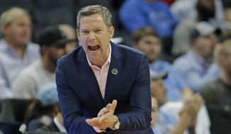 UMBC head coach Ryan Odom directs his team against Kansas State during the first half of a second-round game in the NCAA men's college basketball tournament in Charlotte, N.C., Sunday, March 18, 2018. (AP Photo/Bob Leverone) **FILE**