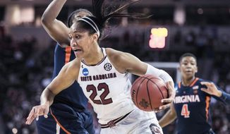 South Carolina forward A'ja Wilson (22) drives to the hoop against Virginia guard Jocelyn Willoughby, right, during the first half of a second-round game of the NCAA women's college basketball tournament, Sunday, March 18, 2018, in Columbia, S.C. (AP Photo/Sean Rayford)
