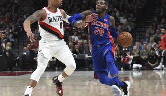 Detroit Pistons guard Dwight Buycks tries to get past Portland Trail Blazers guard Damian Lillard during the first half of an NBA basketball game in Portland, Ore., Saturday, March 17, 2018. (AP Photo/Steve Dykes)