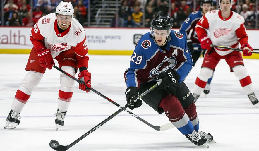 Colorado Avalanche center Nathan MacKinnon skates against Detroit Red Wings right wing Anthony Mantha (39) during the first period of an NHL hockey game on Sunday, March 18, 2018, in Denver. (AP Photo/Jack Dempsey)