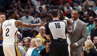 New Orleans Pelicans coach Alvin Gentry challenges an official on a foul call during the second half of an NBA basketball game against the Houston Rockets in New Orleans, Saturday, March 17, 2018. The Rockets won 107-101. (AP Photo/Gerald Herbert)