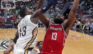 New Orleans Pelicans forward Cheick Diallo (13) blocks a shot by Houston Rockets guard James Harden during the second half of an NBA basketball game in New Orleans, Saturday, March 17, 2018. The Rockets won 107-101. (AP Photo/Gerald Herbert)