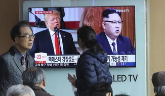 "In this March 17, 2018, photo, people pass by a TV screen showing North Korean leader Kim Jong Un, right, and U.S. President Donald Trump during a news program at the Seoul Railway Station in Seoul, South Korea. Top U.S., South Korean and Japanese officials have discussed how to achieve a complete denuclearization of the Korean Peninsula ahead of upcoming inter-Korean and U.S.-North Korean summit talks. The signs read: "" The possible reshuffle of U.S. National Security Adviser H.R. McMaster."" (AP Photo/Ahn Young-joon)"