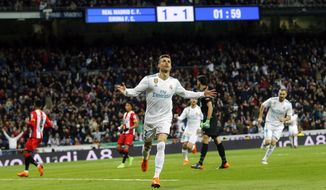 Real Madrid's Cristiano Ronaldo celebrates after scoring his second goal during a Spanish La Liga soccer match between Real Madrid and Girona at the Santiago Bernabeu stadium in Madrid, Spain, Sunday, March 18, 2018. (AP Photo/Paul White)