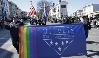 Members of OutVets, a group of gay military veterans, hold a banner and flags as they march in the annual St. Patrick's Day Parade, Sunday, March 18, 2018, in Boston. Boston's popular St. Patrick's Day parade is all about veterans, but not all who've served in uniform were allowed to march in the parade. Veterans for Peace, the anti-war group, wasn't allowed to walk in Sunday's parade. (AP Photo/Steven Senne)