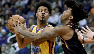 Golden State Warriors guard Quinn Cook looks to shoot past Phoenix Suns guard Elfrid Payton during the first half of an NBA basketball game in Phoenix, Saturday, March 17, 2018. (AP Photo/Chris Carlson)