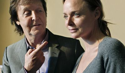 Paul McCartney and his daughter Stella McCartney.  Stella McCartney, Fashion Designer.  Paul McCartney singer-songwriter, multi-instrumentalist, and composer. Bass guitarist and singer for the Beatles  (AP Photo/Thibault Camus)