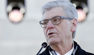 Gov. Phil Bryant, speaks of the guidance of former Gov. William Winter, spearheading the building of the Museum of Mississippi History and the Mississippi Civil Rights Museum, during the grand opening ceremony, Saturday, Dec. 9, 2017, in Jackson, Miss. (AP Photo/Rogelio V. Solis)