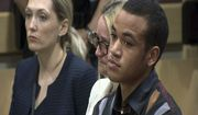 In this image made from video, Zachary Cruz cries as his brother, Nikolas Cruz is arraigned at the Broward County Courthouse in Fort Lauderdale, Fla., Wednesday, March 14, 2018. Cruz is accused of opening fire at Marjory Stoneman Douglas High School in Parkland, Fla., Feb. 14, killing 17 students and adults. (WSVN via AP, Pool)