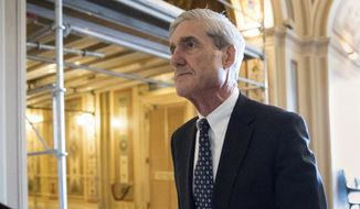 In this June 21, 2017, file photo, special counsel Robert Mueller departs after a meeting on Capitol Hill in Washington. (AP Photo/J. Scott Applewhite, File)