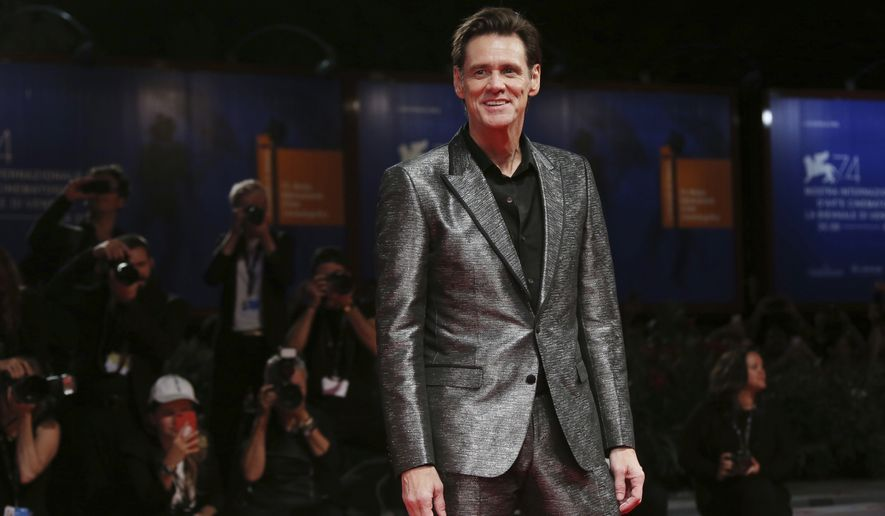 FILE - In this Sept. 5, 2017, file photo, actor Jim Carrey poses for photographers at the premiere of the film 'Jim and Andy: The Great Beyond' at the 74th edition of the Venice Film Festival in Venice, Italy. Carrey is being criticized on social media for a portrait he painted and tweeted Saturday, March 17, 2018, that is believed to be White House Press Secretary Sarah Huckabee Sanders. (Photo by Joel Ryan/Invision/AP, File)