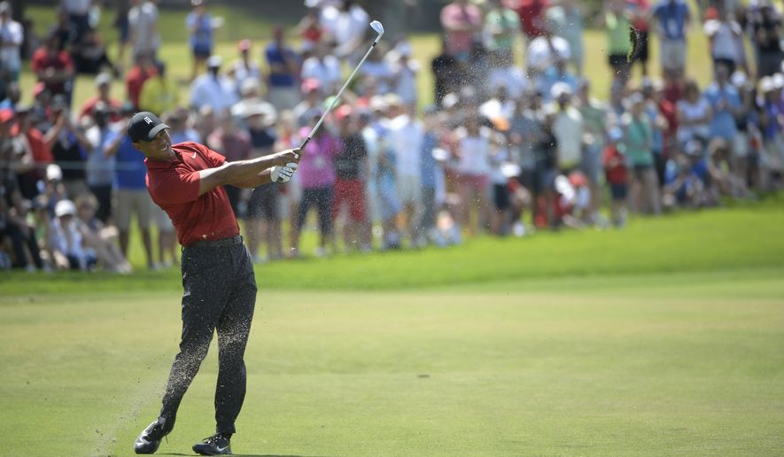 Tiger Woods hits from the third fairway during the final round of the Arnold Palmer Invitational golf tournament Sunday, March 18, 2018, in Orlando, Fla. (AP Photo/Phelan M. Ebenhack) ** FILE **