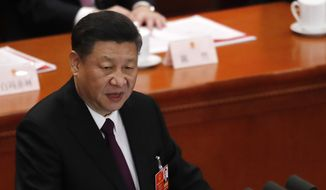 Chinese President Xi Jinping delivers a speech at the closing session of the annual National People's Congress (NPC) at the Great Hall of the People in Beijing, Tuesday, March 20, 2018. (AP Photo/Andy Wong)