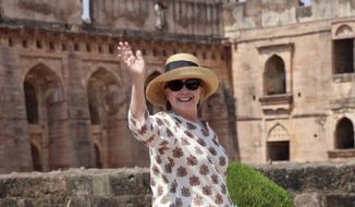 In this  March 12, 2018 photo, former U.S. Secretary of State Hillary Clinton, waves to media as she visits the Jahaz Mahal monument in Mandu, Madhya Pradesh state, India. on March 17, 2018 Clinton wrote on Facebook that she meant no disrespect when she said women voters are more swayed by men  during an interview in India.  (AP Photo, File)