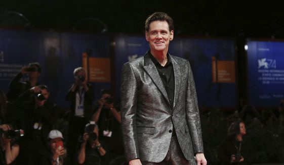 """In this Sept. 5, 2017, file photo, actor Jim Carrey poses for photographers at the premiere of the film """"Jim and Andy: The Great Beyond"""" at the 74th edition of the Venice Film Festival in Venice, Italy. Carrey is being criticized on social media for a portrait he painted and tweeted Saturday, March 17, 2018, that is believed to be White House Press Secretary Sarah Huckabee Sanders. (Photo by Joel Ryan/Invision/AP, File)"""