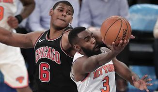 New York Knicks forward Tim Hardaway Jr. (3) puts up a shot against Chicago Bulls center Cristiano Felicio (6) during the third quarter of an NBA basketball game, Monday, March 19, 2018, in New York. The Bulls won 110-92. (AP Photo/Julie Jacobson)