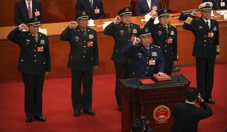 Vice chairmen of China's Central Military Commission take the oath of office during a plenary meeting of China's National People's Congress (NPC) at the Great Hall of the People in Beijing, Sunday, March 18, 2018. China's ceremonial legislature appointed Premier Li Keqiang, the No. 2 leader of the ruling Communist Party, to a second five-year term Sunday and approved the appointment of a director for a new anti-corruption agency with sweeping powers. (AP Photo/Mark Schiefelbein)
