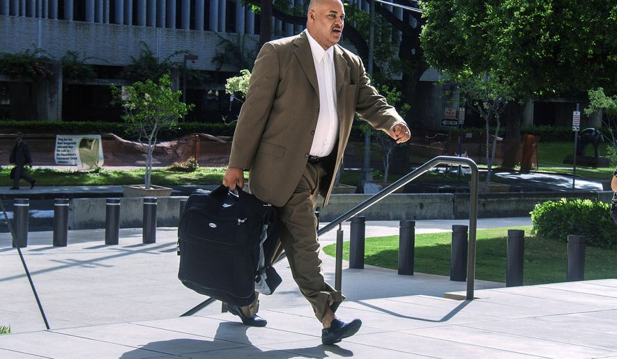 FILE - In this Tuesday, Oct. 4, 2016, file photo, North Carolina concert promoter Marc Hubbard walks to federal court in Honolulu. On Monday, March 19, 2018, U.S. District Judge Leslie Kobayashi ruled that she is not allowing Hubbard to take back his guilty plea to scamming the University of Hawaii out of $200,000 for a Stevie Wonder concert that never happened.   (Dennis Oda/The Star-Advertiser via AP, File)