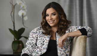 In this March 6, 2018 photo, actress Eva Longoria, who is launching The Eva Longoria Collection clothing line with retailer HSN, poses for a portrait at the Four Seasons Hotel in Los Angeles. Her spring line features ruffled sleeves, graphic tees, floral patterns and feminine pleated skirts meant to be dressed up for work or down with a pair of sneakers. (Photo by Chris Pizzello/Invision/AP)