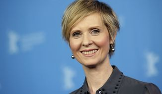 """FILE - In this Sunday, Feb. 14, 2016, file photo, Actress Cynthia Nixon poses for the photographers during a photo call for the film 'A Quiet Passion' at the 2016 Berlinale Film Festival in Berlin, Germany. The former """"Sex and the City"""" star says she'll challenge Gov. Andrew Cuomo in New York's Democratic primary in September. Her announcement Monday, March 19, 2018, sets up a race pitting an openly gay liberal activist against a two-term incumbent with a $30 million war chest and possible presidential ambitions. (AP Photo/Michael Sohn, File)"""