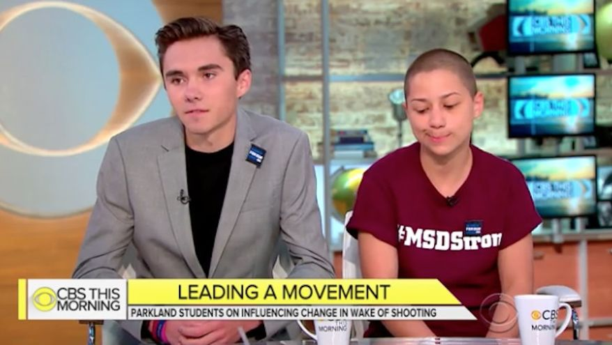 """David Hogg and Emma Gonzalez, two students who survived last month's mass shooting at Marjory Stoneman Douglas High School in Parkland, Florida, said Monday that the National Rifle Association has been """"basically threatening"""" them. (CBS News)"""