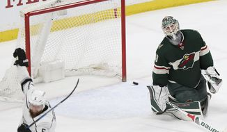 Minnesota Wild's goalie Devan Dubnyk (40) reacts to losing 4-3 in overtime against the Los Angeles Kings in an NHL hockey game Monday, March 19, 2018, in St. Paul, Minn. (AP Photo/Stacy Bengs)